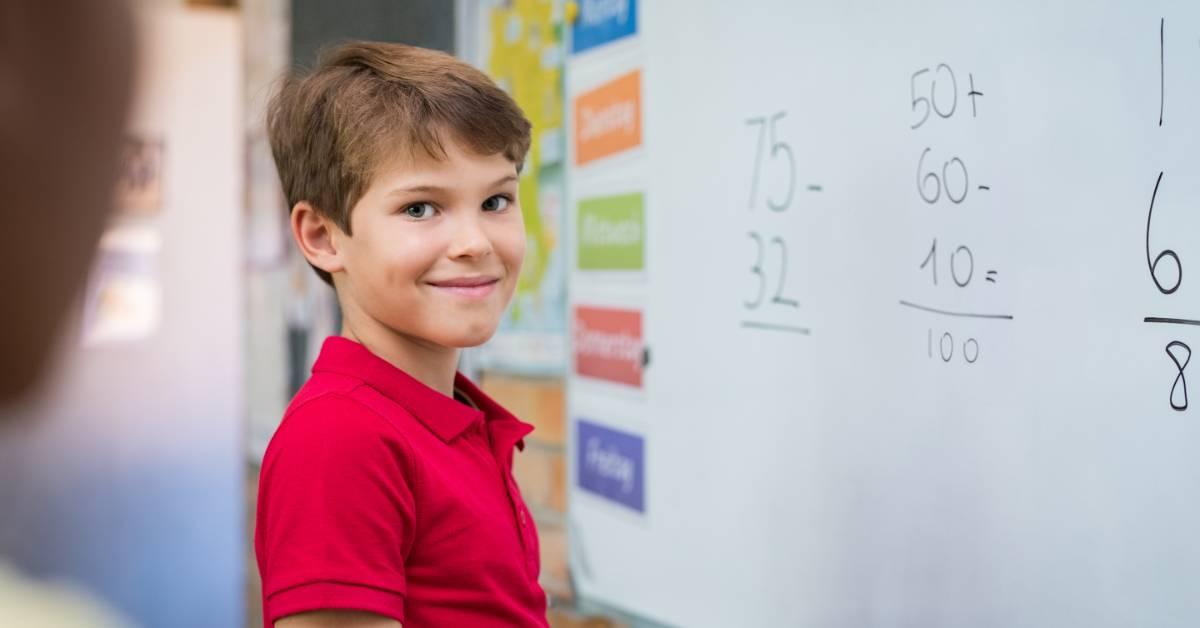 An image of a boy doing math.