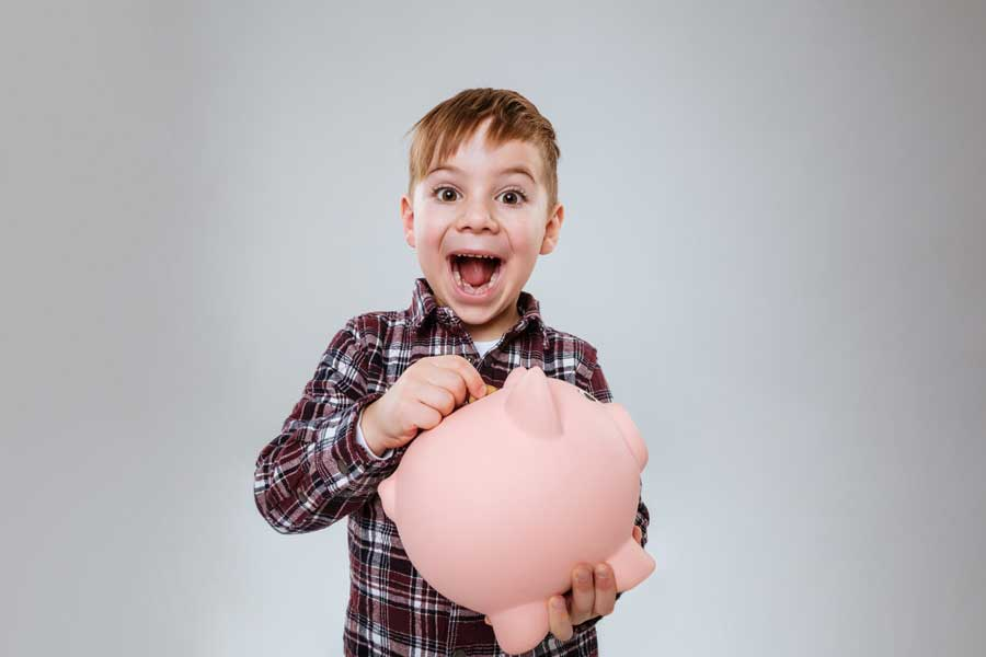 boy learning to save money