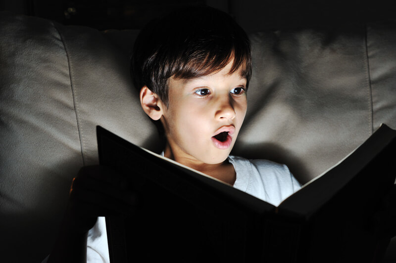 boy is shocked reading book